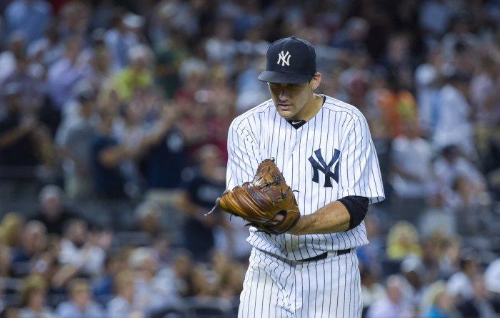 New York Yankees starting pitcher Nathan Eovaldi (30) celebrates end of 8th inning, 8th inning, New York Yankees vs. Houston Astros at Yankee Stadium. Bronx, NY. Monday August 24, 2015. (Corey Sipkin/New York Daily News)